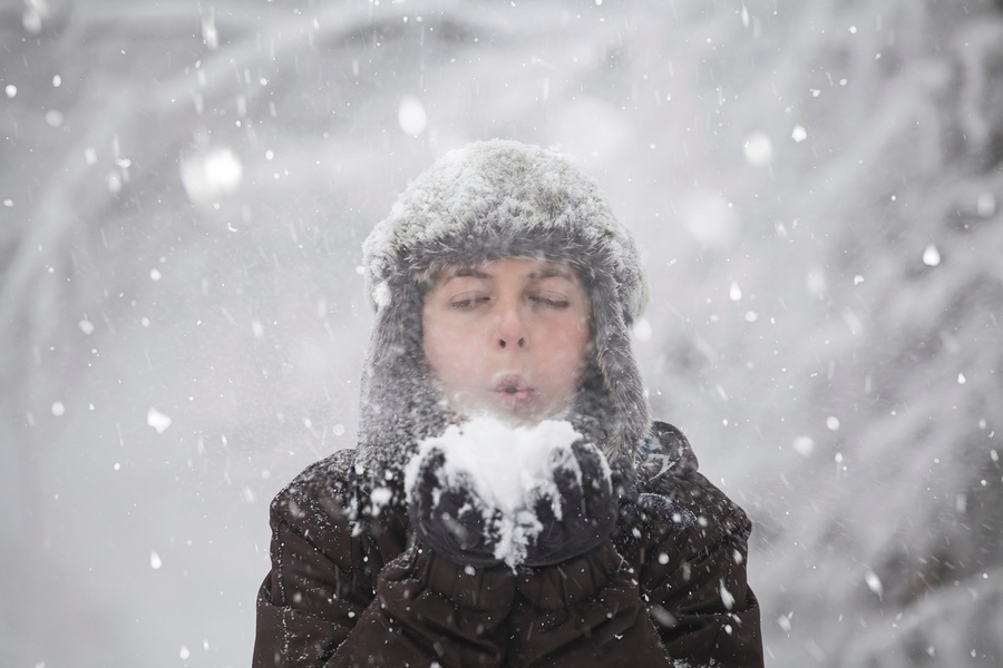 bigstock-Happy-woman-blowing-snow-in-wi-218121985.jpg